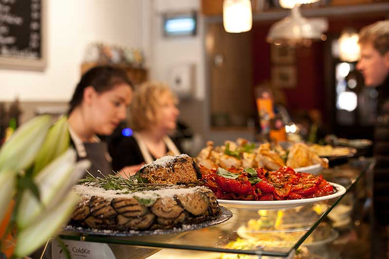 Delicious delicatessen treats with a glass of wine in a cafe setting